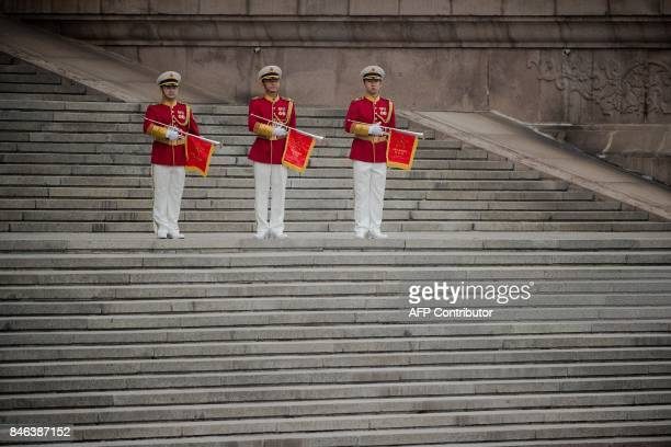 TOPSHOT Members of a Chinese military music band stand guard before a welcome ceremony for Sultan of Brunei Hassanal Bolkiah outside the Great Hall...