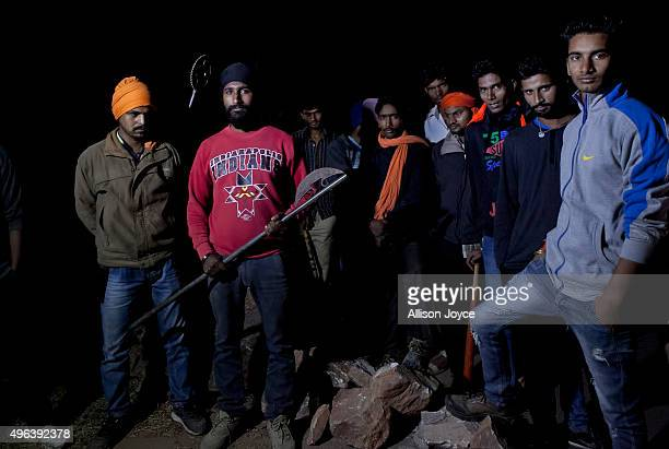 Members of a cow vigilante group pose for a photograph out on a patrol in the hopes of stopping vehicles of cow smugglers November 8 2015 in Ramgarh...