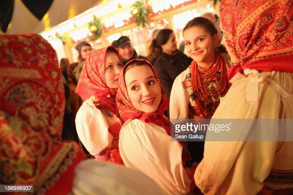 Members of a Croatian folk dance ensemble from Velika Gorica wait to perform at the annual Christmas market at Gendarmenmarkt on its opening day on...