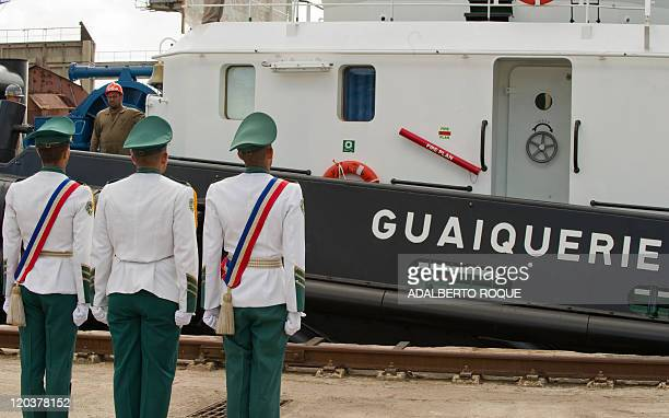 Members of a Cuban military battalion fall in during the flagging of the Guaiquerie towboat docked at Havana's harbor on August 5 2011 Cuba built...