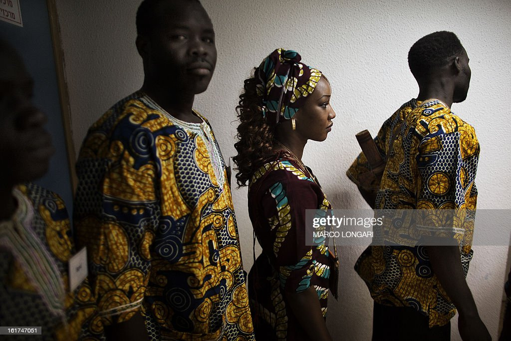 Members of a dance group of Sudanese refugees from the Darfur region dressed with traditional costumes wait backstage before a performance at a cultural centre in south Tel Aviv on February 15, 2013. Hundreds of Sudanese refugees take part in the cultural festival to share with local Israeli audience samples of their cultural heritage.