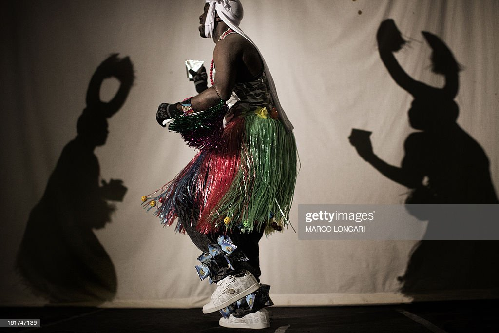 Members of a dance group of Sudanese refugees from the Darfur region dressed with traditional costumes perform on stage at a cultural centre in south Tel Aviv on February 15, 2013. Hundreds of Sudanese refugees take part in the cultural festival to share with local Israeli audience samples of their cultural heritage.