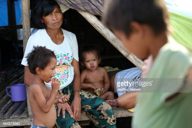 Members of a family are seen inside their tent in an overcrowded sports complex that has been used as a refuge facility for civilians displaced since...