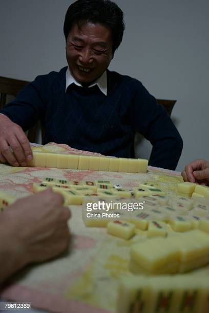 Members of a family make Jiaozi or dumplings on the lunar new year eve February 6 2008 in Beijing China Making dumplings with families is one of the...