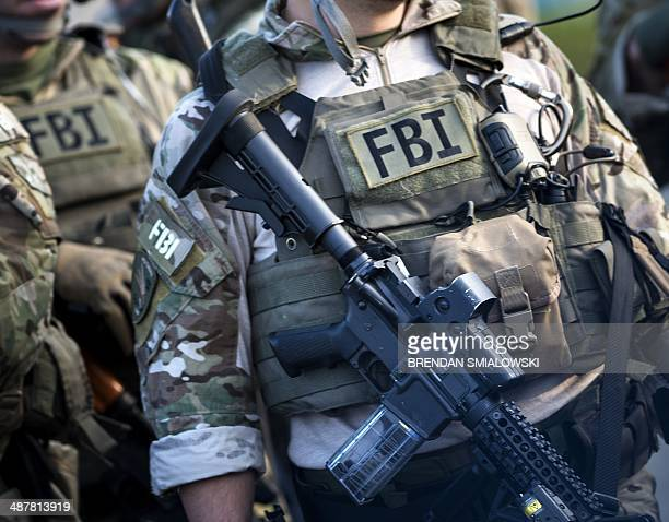 Members of a Federal Bureau of Investigation SWAT team are seen during an FBI field training exercise at the Landmark Mall May 2 2014 in Alexandria...