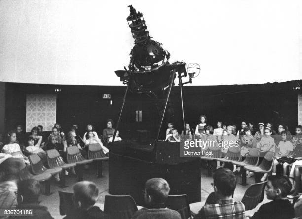 Members of a fifthgrade class gather around the Goto Model M1 projector under the planetarium dome The projector mounted on a floating concrete...