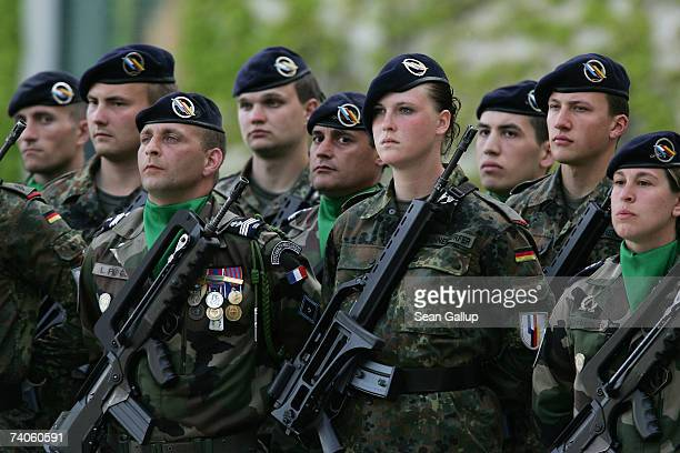Members of a FrancoGerman joint military brigade await the arrival of French President Jacques Chirac at the Chancellery May 3 2007 in Berlin Germany...