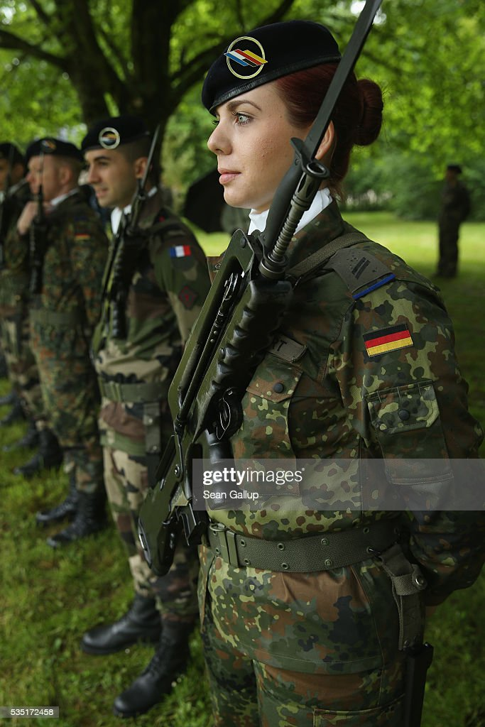 Members of a Franco-German joint military brigade prepare for the arrival French President Francois Hollande and German Chancellor Angela Merkel at the German World War I military cemetery at Consonvoye during ceremonies to commemorate the 100th anniversary of the World War I Battle of Verdun on May 29, 2016 near Verdun, France. The 1916, 10-month battle pitted the French and German armies against one another in a grueling campaign of trench warfare and artillery bombardments that killed a total of approximately 300,000 soldiers. The events today coincide with the 50th anniversary of commemorations held at Verdun by then French President Charles de Gaulle and German Chancellor Konrad Adenauer that paved the way for a new era of peaceful, post-war Franco-German relations.