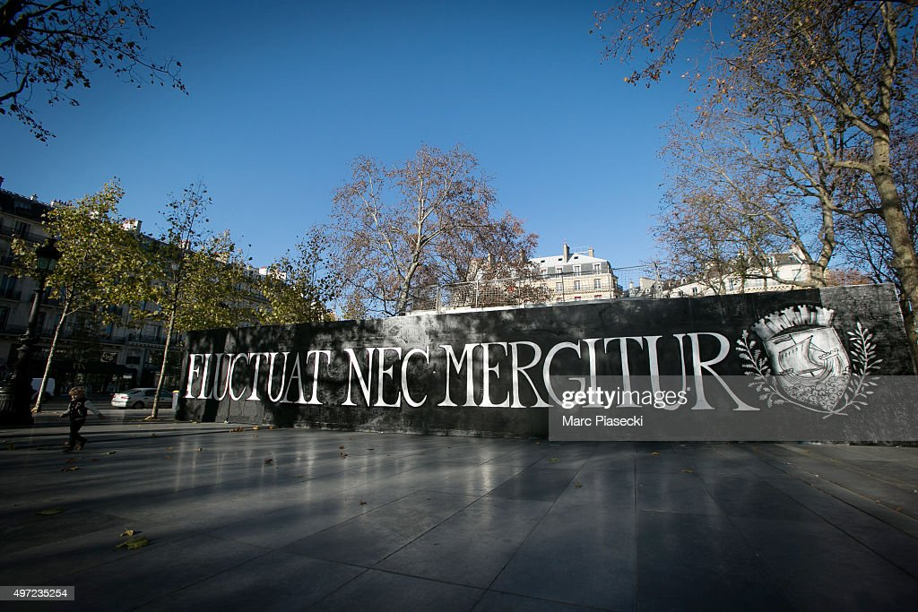 Members of a group of street artists have painted a mural reading Paris' motto 'Fluctuat nec mergitur' a Latin phrase meaning 'Tossed but not sunk'...