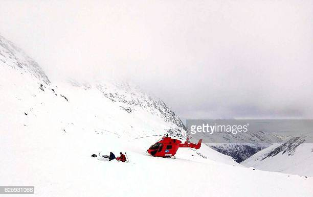 Members of a helicopter rescue team work at the side of the avalanche at the so called 'GurglerGruppe' in Soelden Tyrol where one Person was killed...