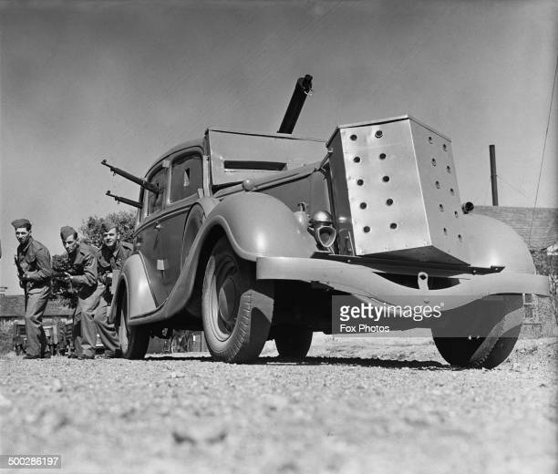 Members of a Home Guard unit attached to the St Martin's Preserving Company factory in Berkshire with an improvised armoured car 19th September 1940