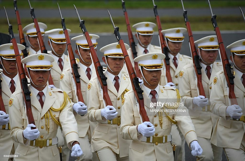 Members of a Japanese honour guard line up as Britain's Prime Minister David Cameron (not pictured) arrives at Chubu Centrair International Airport at Tokoname, Aichi prefecture, outside Nagoya on May 25, 2016 ahead of the 2016 Ise-Shima G7 Summit. World leaders began gathering in Japan on May 25 ahead of a Group of Seven summit set to be dominated by the lacklustre global economy. / AFP / MANAN
