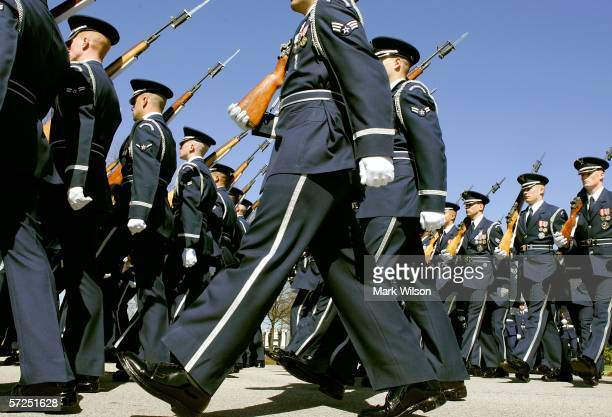 Members of a joint honor guard march during the funeral for Caspar W Weinberger at Arlington National Cemetery April 4 2006 in Arlington Virginia...