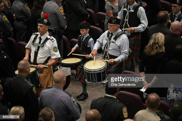 Members of a law enforcement drum corps march during the funeral for TrooperPilot Berke MM Bates at Saint Paul's Baptist Church August 18 2017 in...