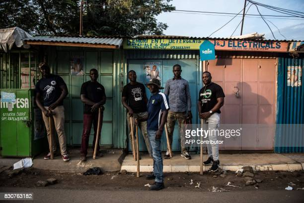 TOPSHOT Members of a local vigilante group of bouncers and bodyguards patrol on August 12 2017 in Kisumi following presidential electionrelated...