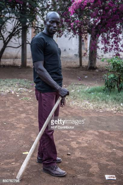 A members of a local vigilante group of bouncers and bodyguards patrols on August 12 2017 in Kisumi following presidential electionrelated violence...