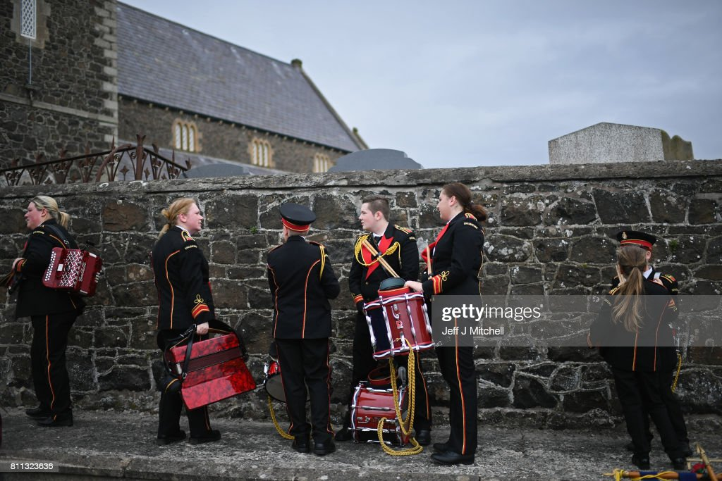 Members of a marching band pause at Drumcree Church on July 9, 2017 in Drumcree, Northern Ireland. The annual Orange marches and demonstrations will take place on the Twelfth of July to celebrate the Battle of the Boyne in 1690 when the Protestant King William of Orange defeated the Catholic King James II on the banks of the river Boyne.