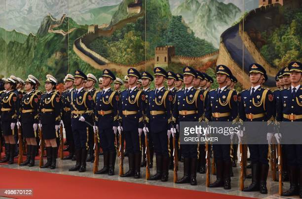 Members of a military honour guard line up before a welcome ceremony for Polish President Andrzej Duda in the Great Hall of the People in Beijing on...