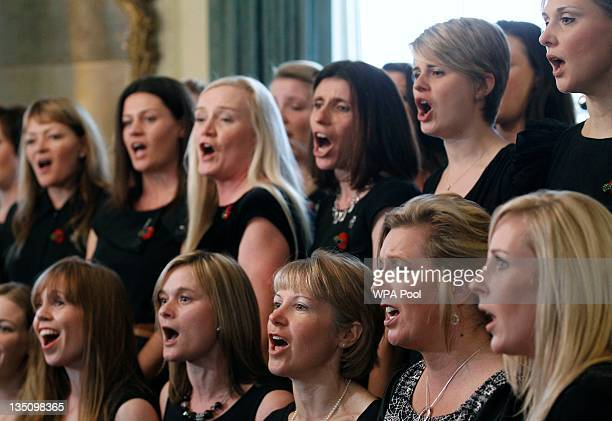 Members of a military wives' choir perform during a reception for service personnel who have returned from the NATO mission in Libya at 10 Downing...