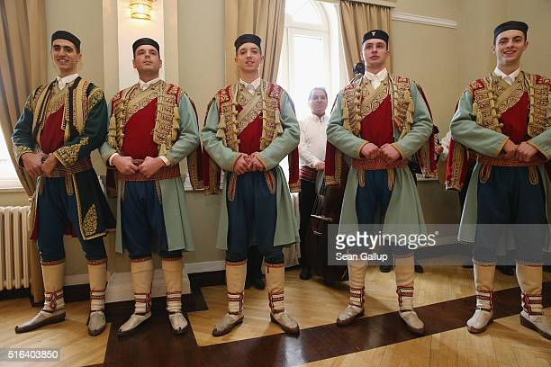 Members of a Montenegran folk dance ensemble prepare to perform for Prince Charles Prince of Wales and Camilla Duchess of Cornwall at a cultural...