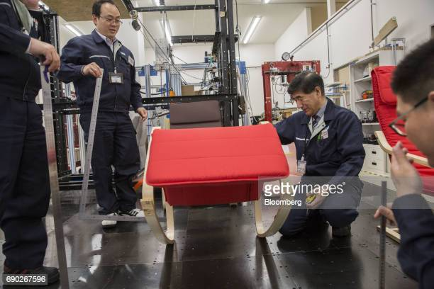 Members of a Nitori Holdings Co quality control team check the movement of a chair during a product test in Tokyo Japan on Tuesday April 25 2017 In...