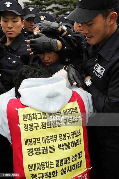 Members of a non fulltime worker's union at Hyundai Motor Corp scuffle with riot police during a rally April 20 2006 in Seoul South KoreaChung told...