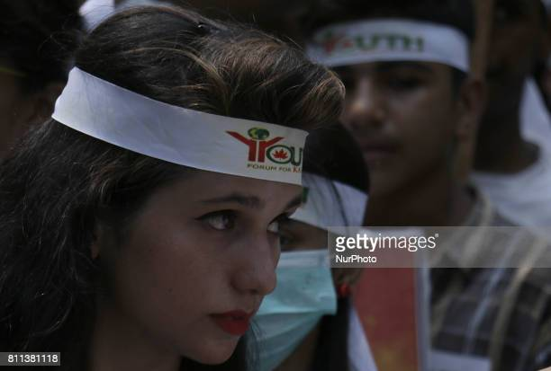 Members of a nongovernmental organization 'Youth Forum for Kashmir' chant anti Indian slogans during a rally to mark 1st anniversary of the death of...