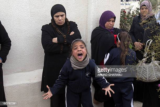 Members of a Palestinian family react after Israeli bulldozers demolished their family house in the Arab east Jerusalem neighborhood of Beit Hanina...