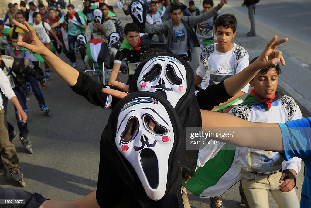 Members of a Palestinian youth skate team in the Gaza Strip wear ghost face masks as they take part in a rally to show solidarity with Palestinian prisoners held inside Israeli jails, ahead of Palestinian prisoner's day in the southern Gaza town of Rafah on April 16, 2013.