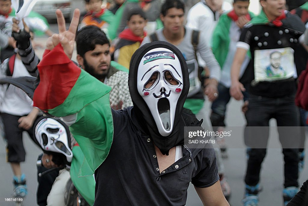 Members of a Palestinian youth skate team in the Gaza Strip wear ghost face masks as they take part in a rally to show solidarity with Palestinian prisoners held inside Israeli jails, ahead of Palestinian prisoner's day in the southern Gaza town of Rafah on April 16, 2013. AFP PHOTO/ SAID KHATIB