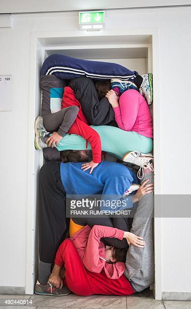 Members of a performance group of Austrian choreograph Willi Dorner rehearse the performance 'always right in the middle' in a door on the fairground...