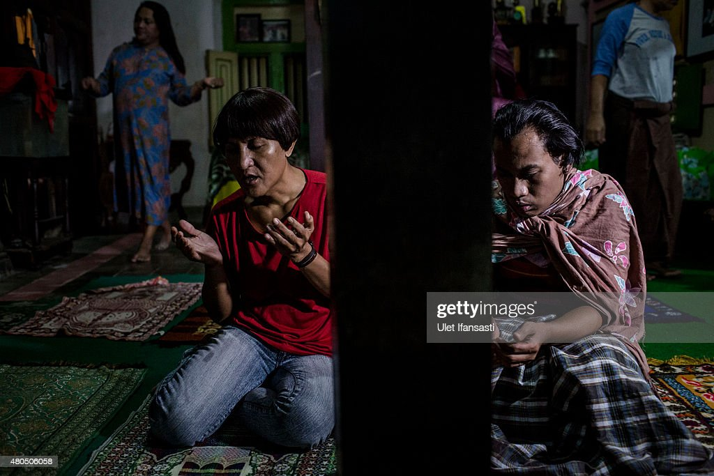 Members of a Pesantren boarding school, Al-Fatah, for transgender people known as 'waria' pray during Ramadan on July 12, 2015 in Yogyakarta, Indonesia. During the holy month of Ramadan the 'waria' community gather to break the fast and pray together. 'Waria' is a term derived from the words 'wanita' (woman) and 'pria' (man). The Koran school Al-Fatah was set back last year's by Shinta Ratri at her house as a place for waria to pray, after their first founder Maryani died. The school operates every Sunday. Islam strictly segregates men from women when praying, leaving no-where for 'the third sex' waria to pray before now.