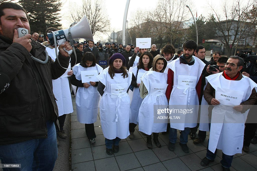 Members of a pro-Kurdish party stage a protest against the Turkish government in Ankara on December 28, 2012 on the first anniversary of a Turkish military air strike aimed at Kurdish rebels that killed 34 civilians at the Turkey-Iraq border.