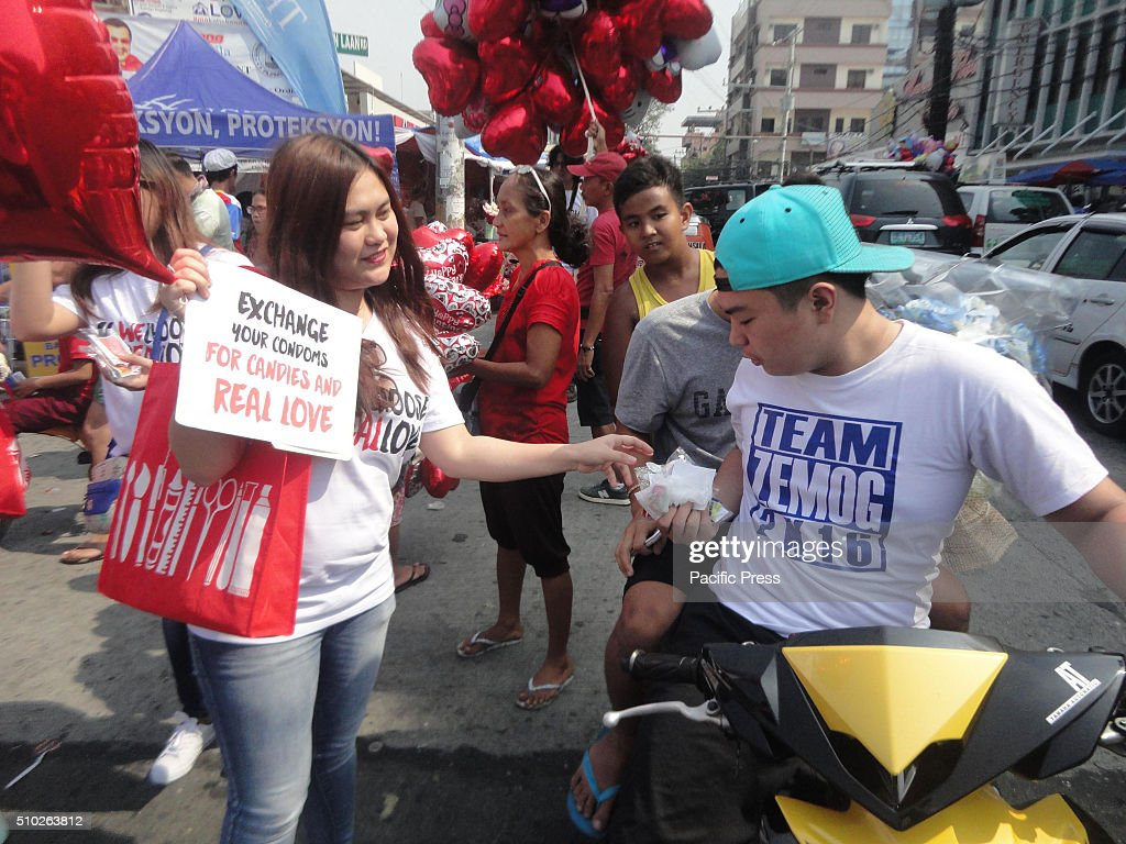 Members of a pro-life group give away candies in exchange for condoms at the Dangwa flower market in Manila, Philippines on Valentine's Day. Valentines Day is celebrated on February 14 every year.