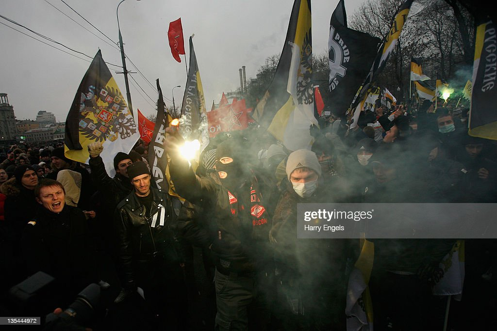 Members of a Russian Nationalist group burn a flare in Bolotnaya Square on December 10, 2011 in Moscow, Russia. Protests took place in Moscow and St. Petersburg this week amid allegations from both domestic critics and international observers that the recent Duma Elections were rigged. Russia's ruling party, United Russia, lost their parliamentary majority but still won close to 49.5 percent of the vote.