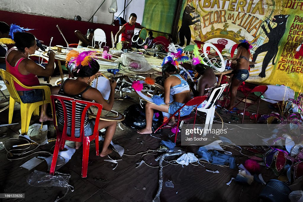 Members of a samba school work on carnival costumes (fantasias, in portuguese) inside the workshop in Rio de Janeiro, Brazil, 15 February 2012. The carnival preparations start early in July or August, some 7-8 months before the main samba schools parade at the sambodrome. Samba schools hire teams of professional designers and artists who, according to the original theme selected by the school directors and then featured by the school during the parade, create allegorical floats, costumes, sculptures, music, choreography and the entire school show. However, the most of the everyday work in the carnival hangars is performed by unknown but fully dedicated samba schools members.
