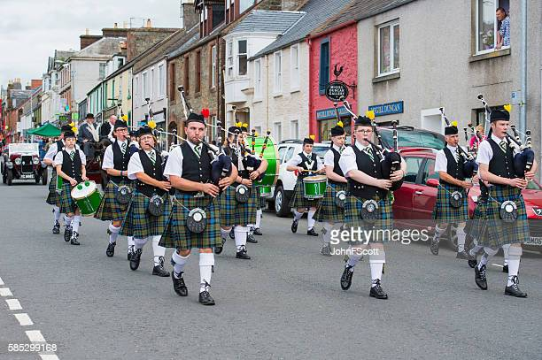 Members of a Scottish pipe band in a summer parade