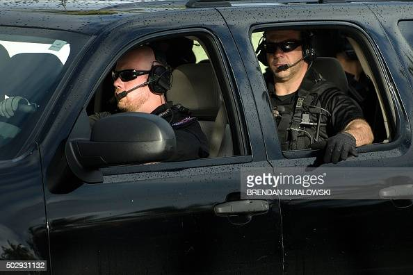 Members of a Secret Service counter assault team are seen escorting US President Barack Obama while traveling to Marine Corps Base Hawaii to visit...