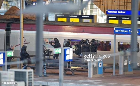 Members of a special unit of Dutch police are in action near a Thalys train on a platform of Rotterdam central station on September 18 as a man has...