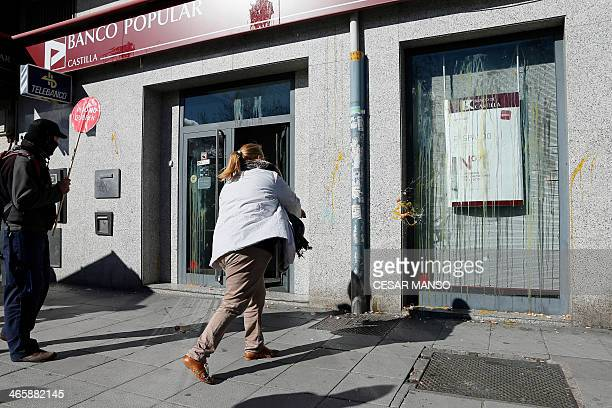 Members of a stopeviction association throw eggs at a Banco Popular branch after the cancelation of an eviction during a demonstration originally...