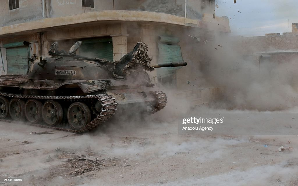 Members of a Syrian opposition group attack the headquarters of Assad regime forces in the villages of Nubul and al-Zahraa in Aleppo, Syria on February 12, 2016.