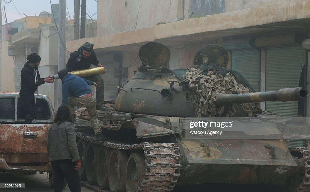Members of a Syrian opposition group load weaponry before they attack the headquarters of Assad regime forces in the villages of Nubul and al-Zahraa in Aleppo, Syria on February 12, 2016.