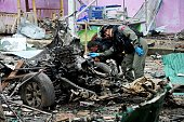 Members of a Thai bomb squad inspect the site of a car bomb blast triggered by suspected separatist militants in the Sungai Kolok district of...