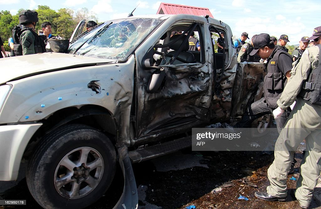 Members of a Thai bomb squad unit inspect the wreckage of a vehicle caused from bomb attacks by militants in Yala province on March 2, 2013. Motorcycle bomb killed at least one ranger and injured nine others including two villagers in restive southern Thailand, army spokesman said.