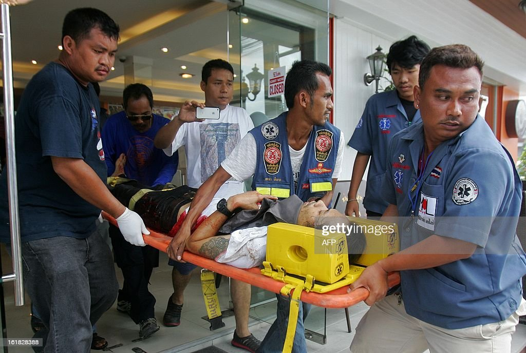 Members of a Thai rescue team carry a victim, injured in an explosion detonated by suspected separatist militants at the clock tower intersection in Pattani town on February 17, 2013. A shadowy insurgency calling for greater autonomy has plagued Thailand's far south near the border with Malaysia since 2004, claiming more than 5,300 lives, both Buddhist and Muslim. AFP PHOTO/Tuwaedaniya MERINGING