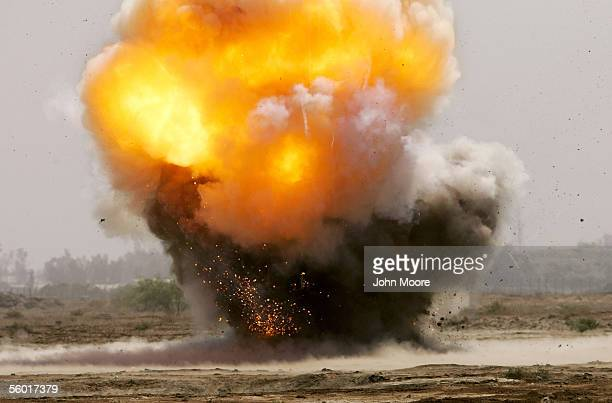Members of a US Army bomb disposal team destroy mortars artillery pieces and other explosives found in roadside bombs known as improvised explosive...