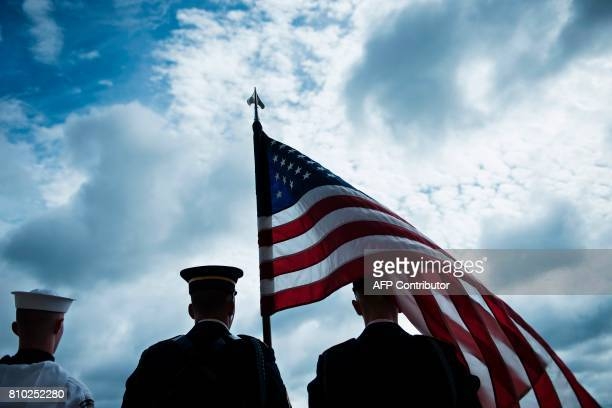 Members of a US color guard wait to greet Britain's Secretary of Defense Michael Fallon at the Pentagon on July 7 2017 in Washington DC / AFP PHOTO /...