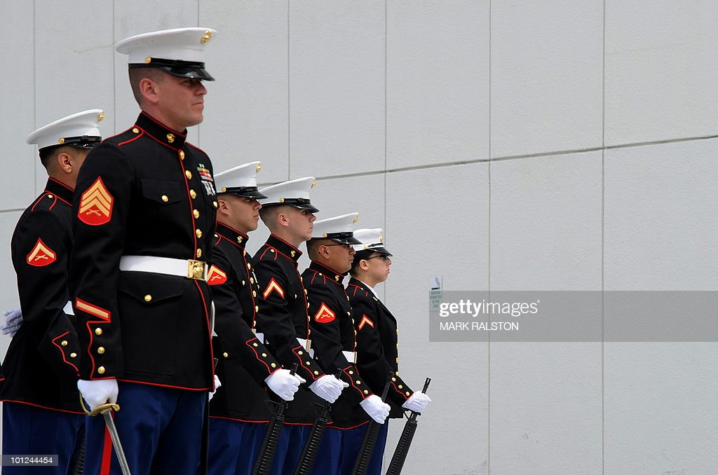 Members of a US Marine Corps honor guard stands to attention during a memorial service for Special Agents and their law enforcement and military colleagues killed in the line of duty, at the Federal Building in Los Angeles on May 28, 2010. Memorial Day, which was formerly known as Decoration Day, commemorates U.S. men and women who died while in the service to their country and was first enacted to honor Union soldiers of the American Civil War. AFP PHOTO/Mark RALSTON