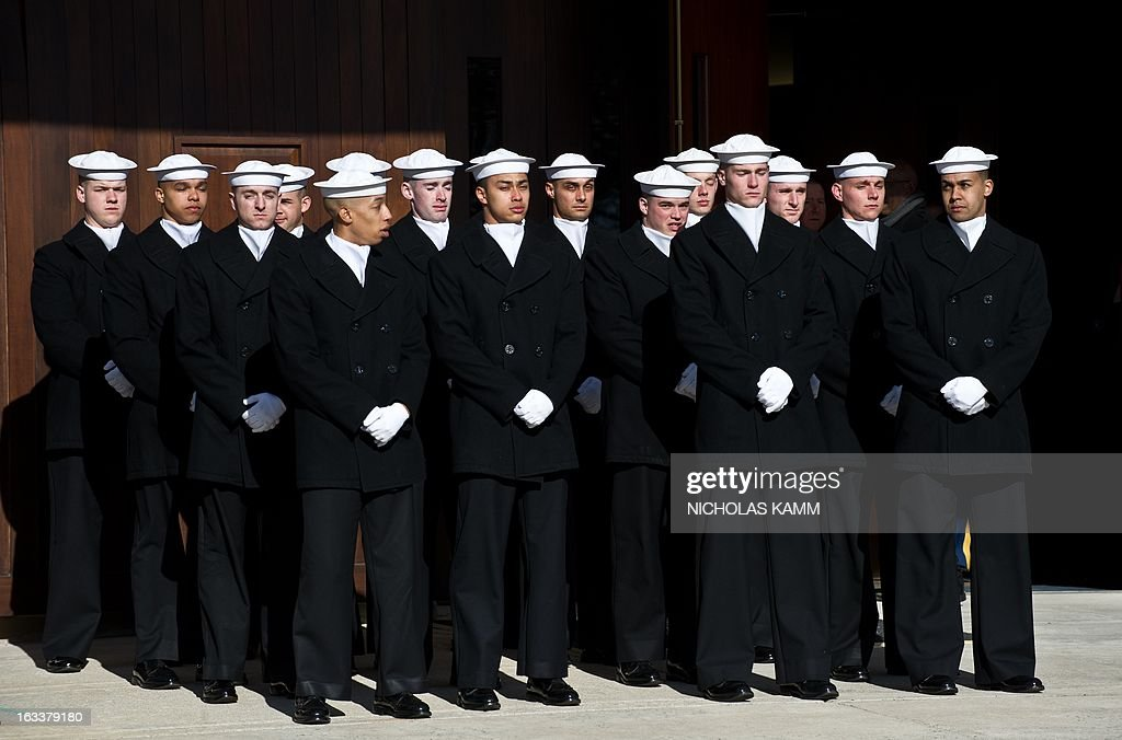 Members of a US Navy ceremonial team await a funeral service for two unknown sailors who were killed in 1862 when the Civil War ironclad USS Monitor sank off the coast of North Carolina at Arlington National Cemetery on March 8, 2013 in Arlington, Virgina. The sailors' remains, recovered when a portion of the ship was raised eleven years ago, were buried with full military honors. AFP PHOTO/Nicholas KAMM