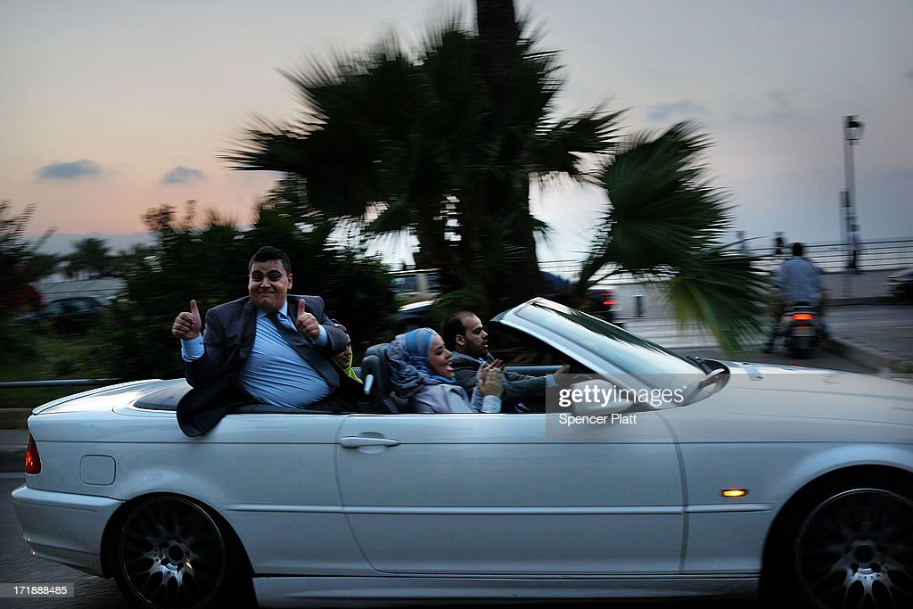 Members of a wedding party drive along the corniche on June 29, 2013 in Beirut, Lebanon. Currently the Lebanese government officially hosts 546,000 Syrians with an estimated additional 500,000 who have not registered with the United Nations. Lebanon, a country of only 4 million people, is now home to the largest number of Syrian refugees who have fled the conflict. The situation is beginning to put a huge social and political strains on Lebanon as there is currently no end in sight to the war in Syria.